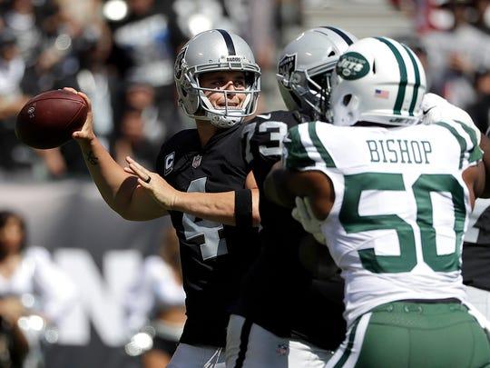 Oakland Raiders quarterback Derek Carr (4) passes as
