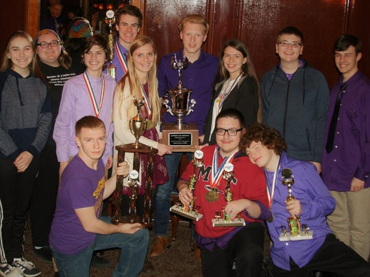 Campbell County High School academic team members hoist a state championship quick recall team trophy and second place overall standings trophy for their best-ever finish for a Northern Kentucky school March 13 at Kentucky Governor's Cup finals in Louisville.