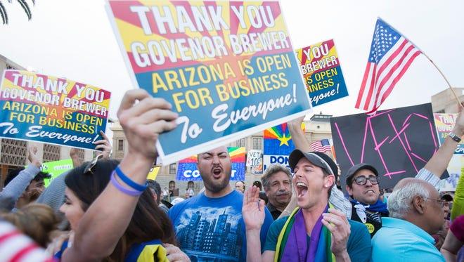 Protesters in 2014 celebrate after  Arizona Gov. Jan Brewer vetoes SB 1062.
