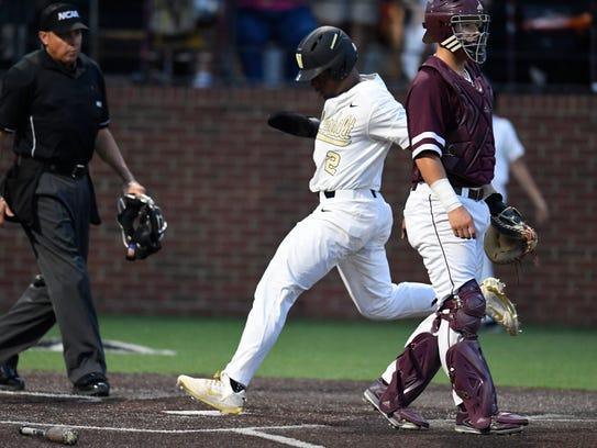 Vanderbilt third baseman Harrison Ray (2) scores the