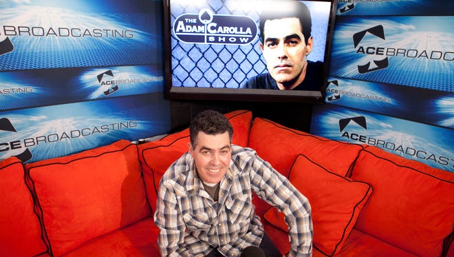 Comedian Adam Carolla is fighting a copyright infingement suit against his company.