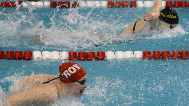 Ursuline Academy senior Sydney Lofquist, middle, holds a slim advantage over Troy's Shelly Zelnick, bottom, and St. Ursula's Josie Grote, top, under water, in the 200 individual medley Sunday at Miami University.