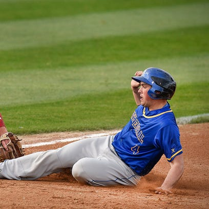 Cathedral's Jack Schramel, right, slides safely into second before the tag attempt by Orono's Kevin Kvern during the fourth inning Monday, May 2, at Joe Faber field in St. Cloud.