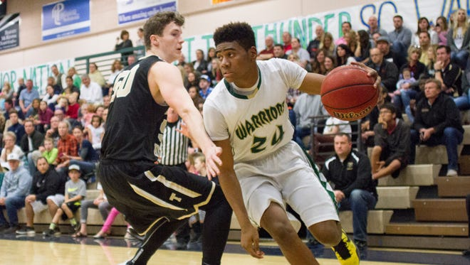 Warriors defend the Jungle with a 71-52 win over Desert Hills Wednesday, Jan. 27, 2016.