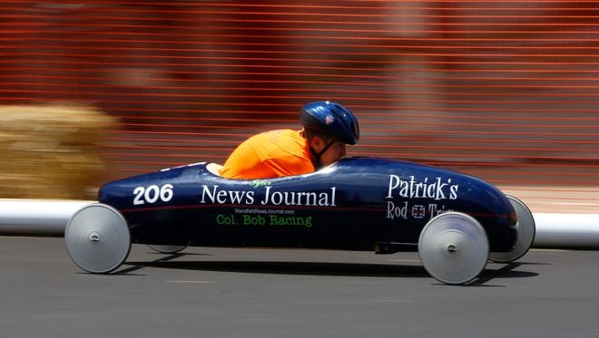 Tyler Hall races down North Main Street during the annual North Central Ohio Soap Box Derby on Saturday. Children and teenagers from seven counties competed to win the championship.