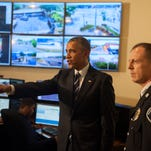 President Barack Obama tours the Real-Time Tactical Operational Intelligence Center in the Camden County Police Administration Building with Police Chief Scott Thomson last week.