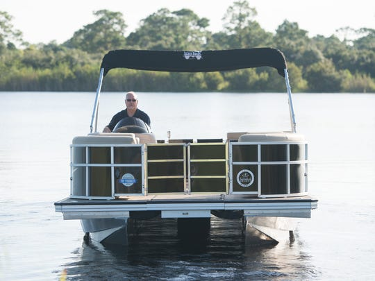 Tim Poppell, president of Island Boats, sits on the Island Boat 22/26 in the expanded position.