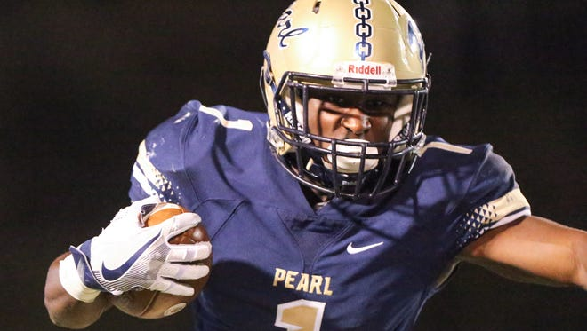 Pearl High School's Javerous Pierce (1) runs for a gain in the third quarter. Brandon and Pearl played in a Class 6A football game on Friday, November 4, 2016. Photo by Keith Warren