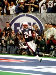 New England Patriots cornerback Ty Law celebrates after