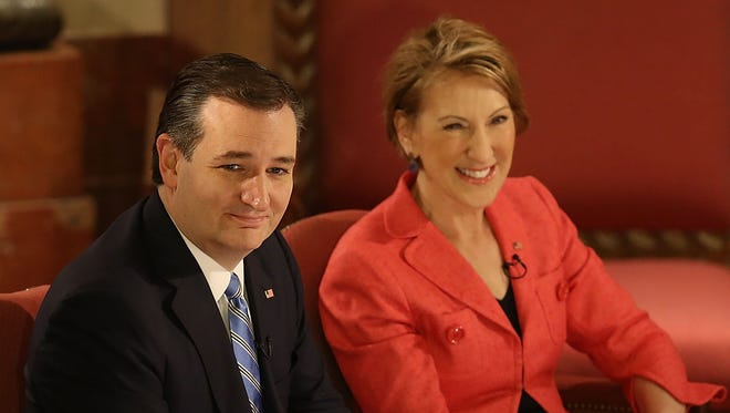 """Republican presidential candidate Sen. Ted Cruz (R-Texas) and his vice presidential candidate, former Hewlett-Packard Co. CEO Carly Fiorina, participate April 29, 2016, in a taping of Fox News' """"The Sean Hannity Show"""" at the Indiana War Memorial in Indianapolis."""