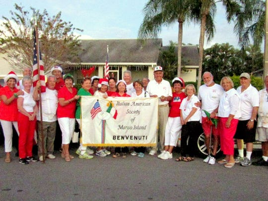 "The Italian American Society of Marco Island sported red, green and white colors to march in the annual Christmas parade. Lots of ""Buon Natale"" as well as ""Merry Christmas"" was shouted out to the spectators along with candy for the children."