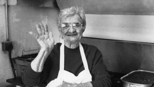 Waukee's Alice's Road is named for Alice Nizzi, longtime proprietor of Alice's Spaghetti Land. Plans to change the road's name are creating controversy.