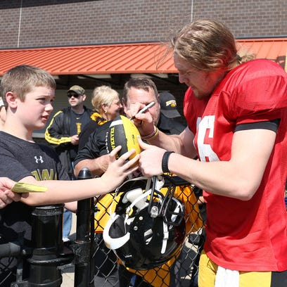 C.J. Beathard, shown signing autographs at Valley Stadium