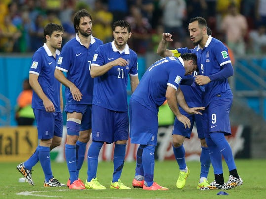 Greece's Fanis Gekas, second right, is consoled after missing a kick during a penalty shootout at the end of the World Cup round of 16 soccer match between Costa Rica and Greece at the Arena Pernambuco in Recife, Brazil, Sunday, June 29, 2014. Costa Rica won 5-3 on penalties after the match ended 1-1. (AP Photo/Andrew Medichini)