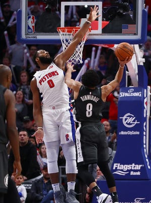 Nets guard Spencer Dinwiddie makes the game-winning shot over Pistons center Andre Drummond in the fourth quarter of the Pistons' 101-100 loss on Sunday, Jan. 21, 2018, at Little Caesars Arena.