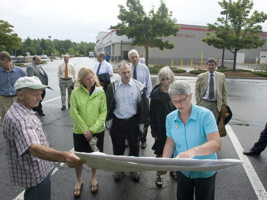 The Act 250 district commission reviews plans in August 2012 for the proposed location of gas pumps at the Costco warehouse in Colchester.