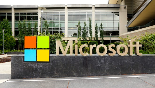 This photo taken July 3, 2014 shows the Microsoft Corp. logo outside the Microsoft Visitor Center in Redmond, Wash.