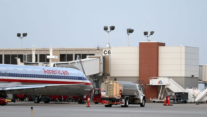 A plane sits at a terminal at the Des Moines airport.
