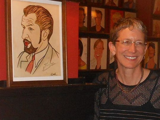 Victoria Price with the Vincent Price portrait at Sardi's.
