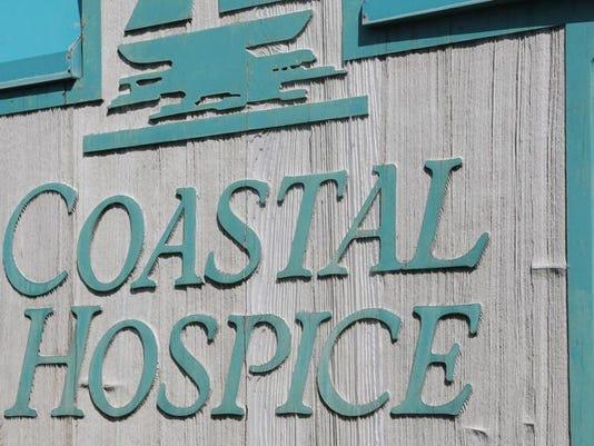 coastal hospice sign