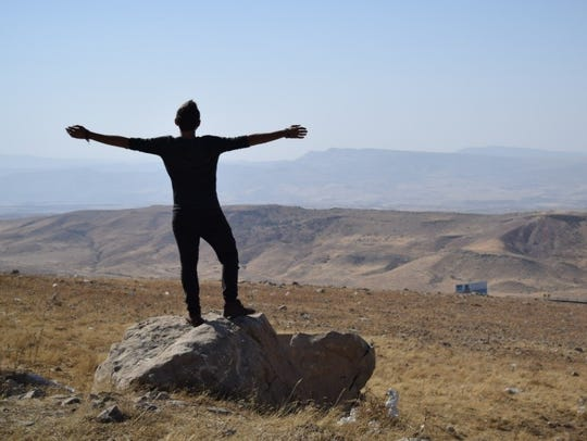 Sal Lavallo standing on a rock in Iraq.
