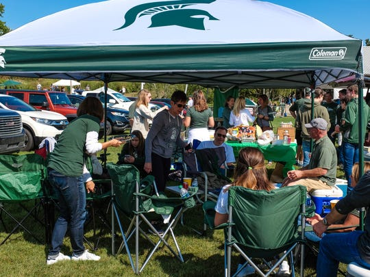 Friends and family enjoy a tailgate party at Munn Field,