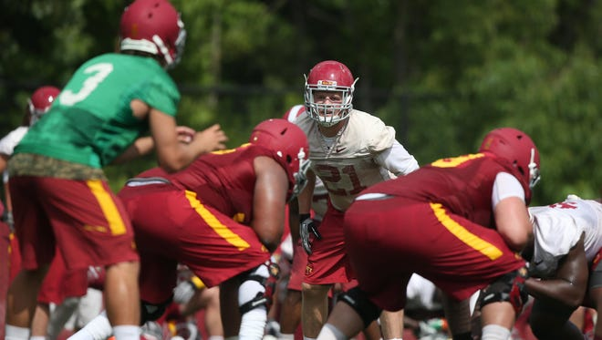 Iowa State junior linebacker Luke Knott eyes junior quarterback Grant Rohach during an open practice on Friday, Aug. 7, 2015, at the Iowa State practice facility near Jack Trice Stadium in Ames, Iowa.
