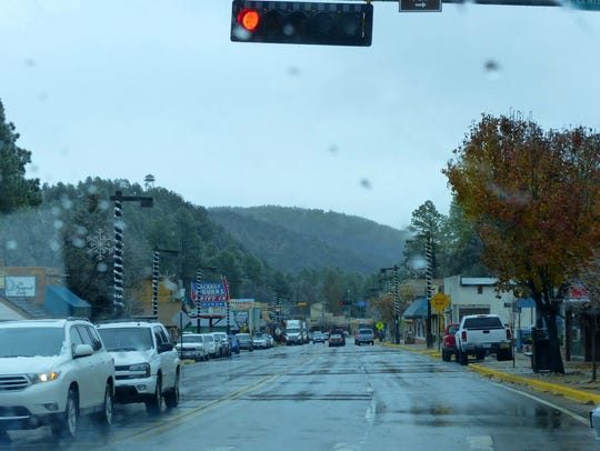 Shoppers in midtown Ruidoso ducked and dogged the wet