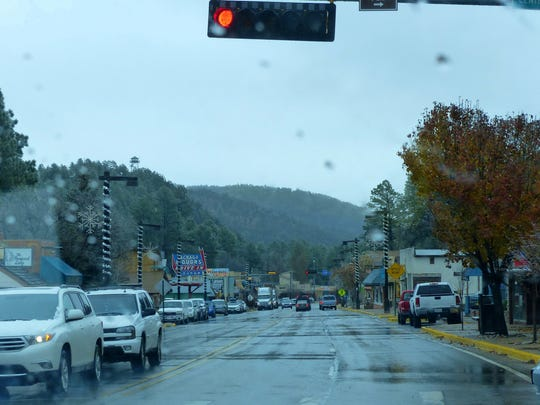 Shoppers in midtown Ruidoso ducked and dogged the wet weather on Black Friday after Thanksgiving.