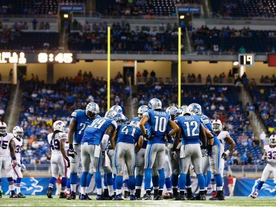 The Detroit Lions huddle against the Buffalo Bills at Ford Field on Sept. 3, 2015.