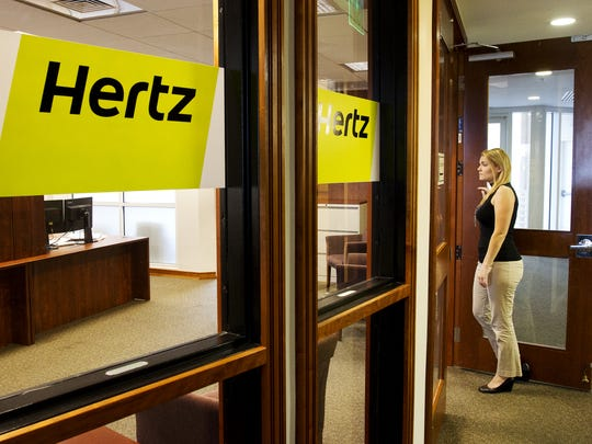 Cara Skeen, a lead receptionist at the Hertz Naples headquarters holds the door for a new employee on Monday 4/28/2014. Skeen is a local hire. The company is coming up on its one year anniversary of its announcement to move to Southwest Florida from Park Ridge, New Jersey.