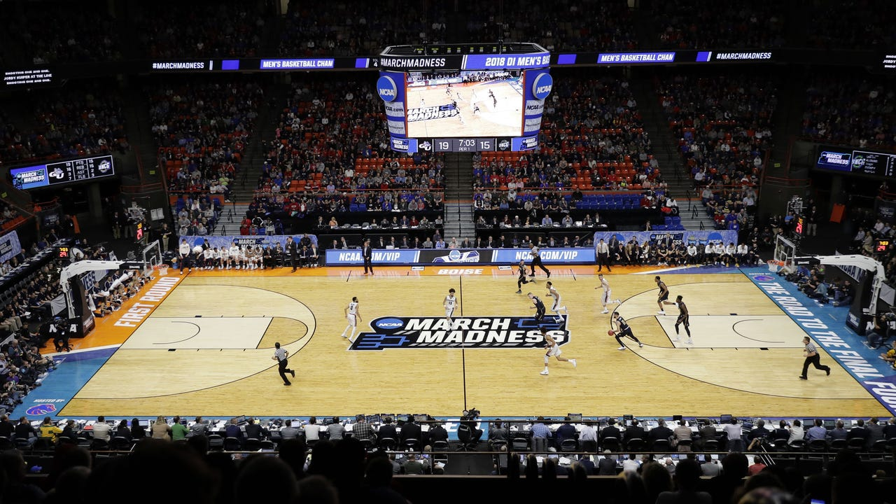 A workplace expert says the NCAA basketball tournament could cost more than $2 billion in lost productivity, between time people spend filling out brackets and watching games at the office. (March 15)