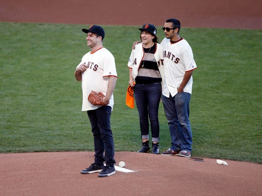 Robin Williams' children, Zak, Zelda and Cody, threw out the ceremonial first pitch before game five of the 2014 World Series between the San Francisco Giants and the Kansas City Royals on Oct. 26.