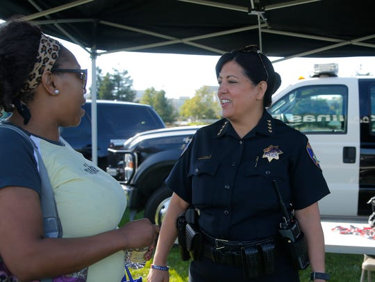 Salinas resident Elitha Clay visits with Salinas Police