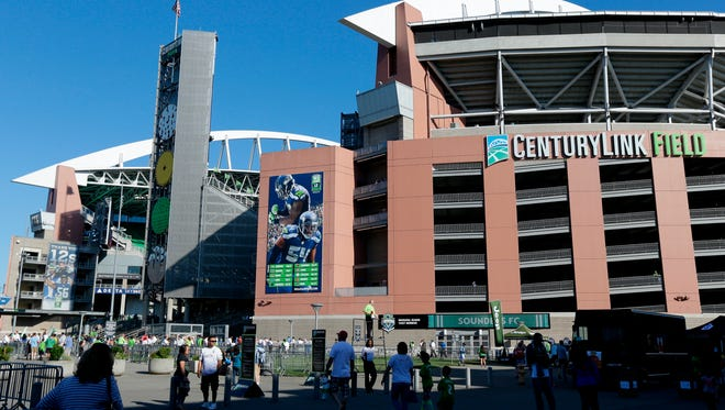 CenturyLink Field is shown with the Seattle Seahawks upcoming NFL football schedule posted on the outside, Saturday, June 13, 2015, in Seattle.