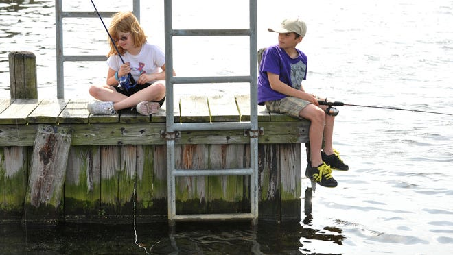 2012: Two young friends fish on the Wicomico River near the Wicomico Boat launching area in Salisbury.