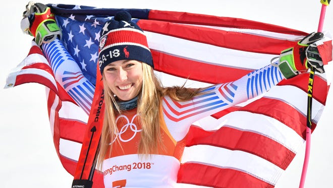 Gold medalist Mikaela Shiffrin  celebrates at the venue victory ceremony after winning the giant slalom.