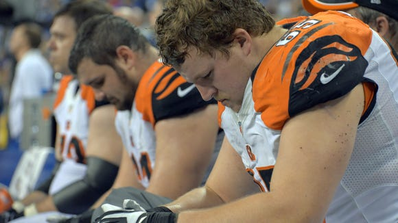 Bengals Center Russell Bodine, left and Guard Clint