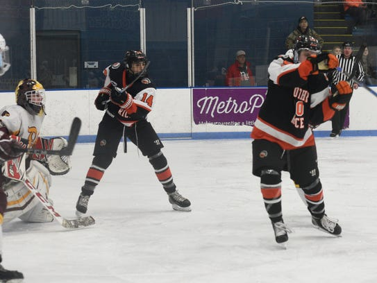 Brother Rice forward Nick Marone (right) deflects a