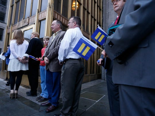 Same-sex couples wait for the Jefferson County courthouse doors to open so they can be legally married, Monday, Feb. 9, 2015, in Birmingham, Ala.