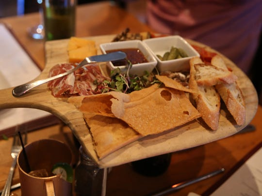 Cured meats and cheeses start dinner at JoJo Bistro and Wine Bar in Pittsford Monday, July 11, 2016.