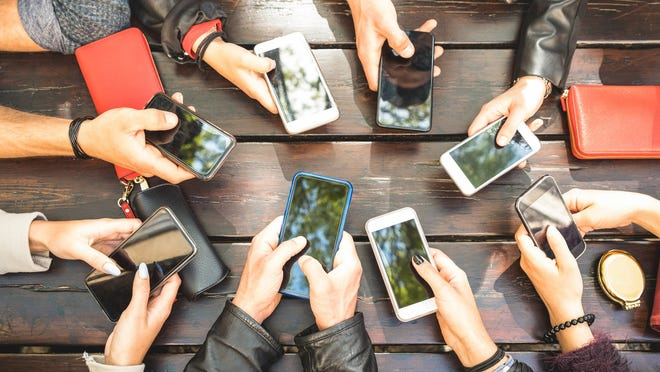 Group of people using smartphones.