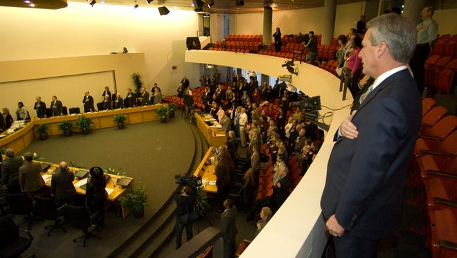 County Mayor Mike Ragsdale puts his hand over his heart during the pledge of allegiance at the  City County Building on January, 31, 2007.  Ragsdale watched from the balcony as the Knox County Commissioners filled 12 seats for outgoing Knox County office holders
