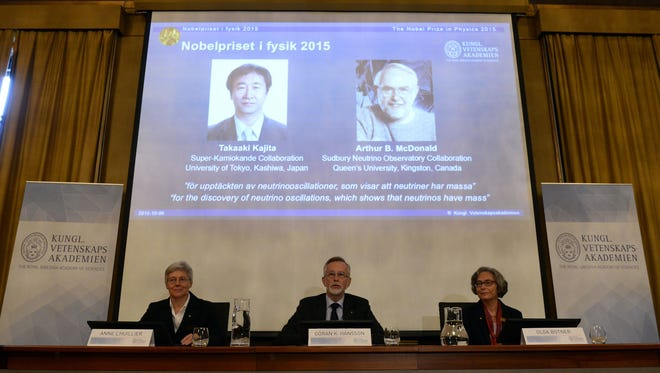 Anne L'Huillier, member of the Nobel Committee for Physics, Goran K Hansson, Permanent Secretary of the Royal Swedish Academy of Sciences, and Olga Botner, member of the Nobel Committee for Physics, sit in front of a screen displaying the winners of the Nobel Prize in Physics 2015 Takaaki Kajita (L) and Arthur B McDonald during a press conference of the Nobel Committee to announce the winner of the 2015 Nobel Prize in Physics on October 6, 2015 at the Swedish Academy of Sciences in Stockholm, Sweden.