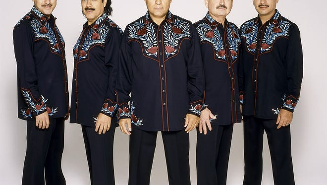 Mexican norteno group Los Tigres del Norte pose for an undated promotional photo provided by Rogers and Cowan. To speak about norteno music without thinking about Los Tigers del Norte is practically impossible. In more than three decades they have sold more than 32 million albums, recorded more than 55, telling immigrants' stories of love, deception and treachery. (AP Photo/Rogers and Cowan, HO)