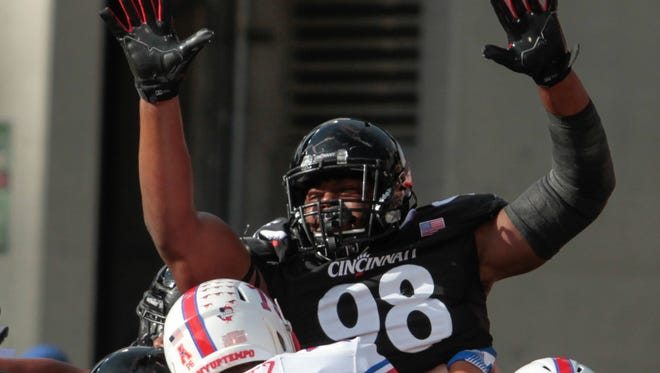 Defensive tackle Lyndon Johnson (98) lately has emerged as a key player for the University of Cincinnati defense.