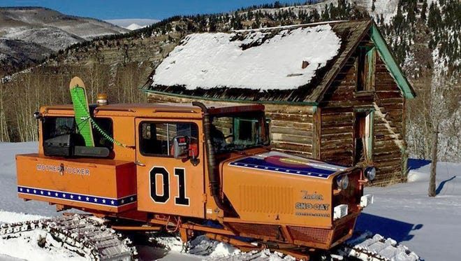 """This undated photo provided by John Brandenburg shows a Sno-Cat co-owned by Brandenburg. Authorities in Colorado are looking for a man suspected of stealing the Sno-Cat fitted out to look like the """"General Lee,"""" the famous car featured in the classic television series """"The Dukes of Hazzard."""" (John Brandenburg via AP)"""