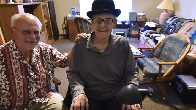 World War II veteran Lester Berns with son John at Lester's Sturgeon Bay residence. The Sister Bay native celebrated his 100th birthday on June 1. Berns serenaded people with his lounge-style music throughout Door County for decades.