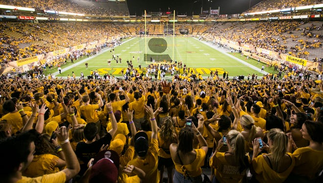 ASU students chant as the team huddles before going back in the tunnel before their game against Cal Poly in the new Student Section in the South Endzone at Sun Devil Stadium in Tempe, AZ on September 12, 2015. Both endzones filled up quickly before the game started.
