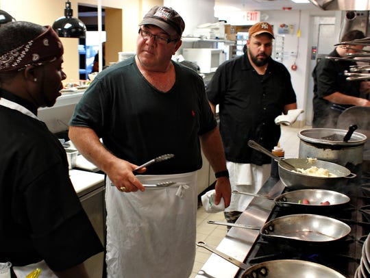 Chef-owner Doug Amaral, center, and his staff were